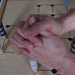 Bilaterales Umfassen eines Solitaire-Spielstabes